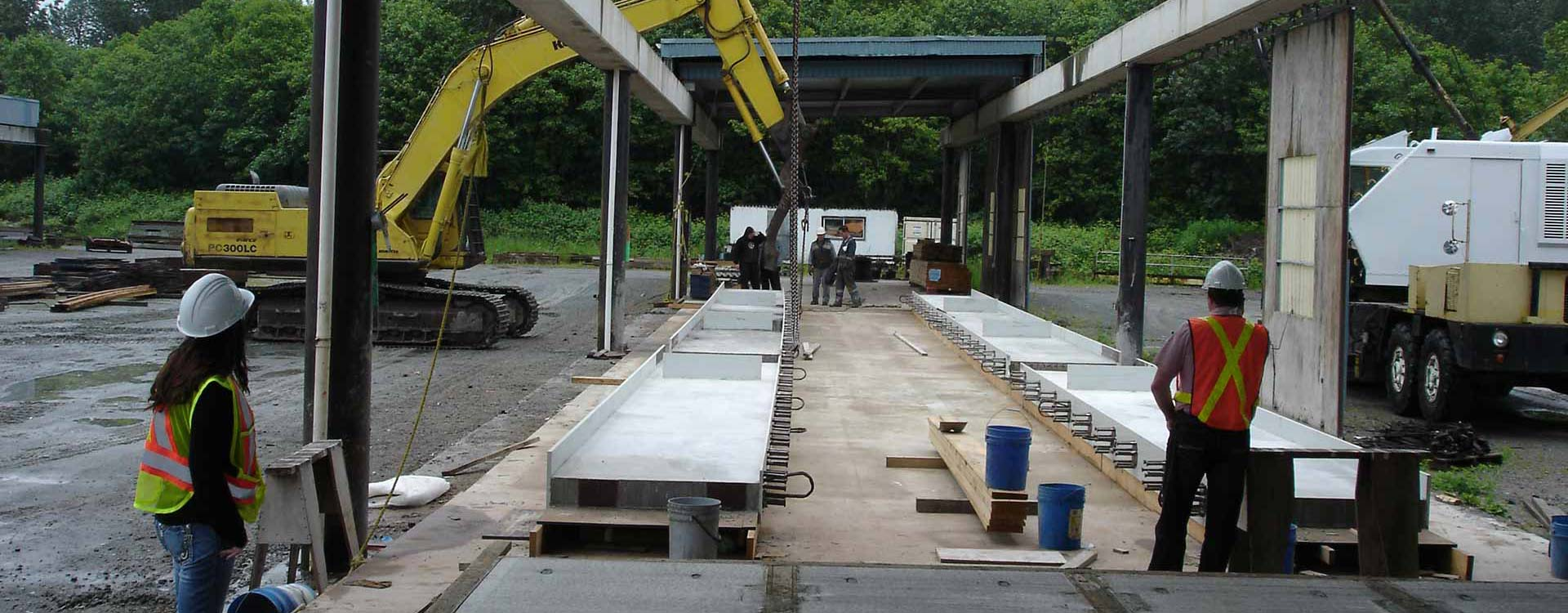 I-beams and Pioneer Precast Products workers