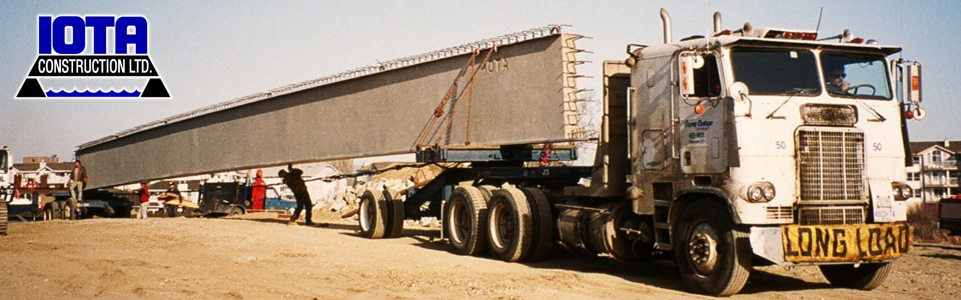 Hauling prefabricated concrete | IOTA Construction